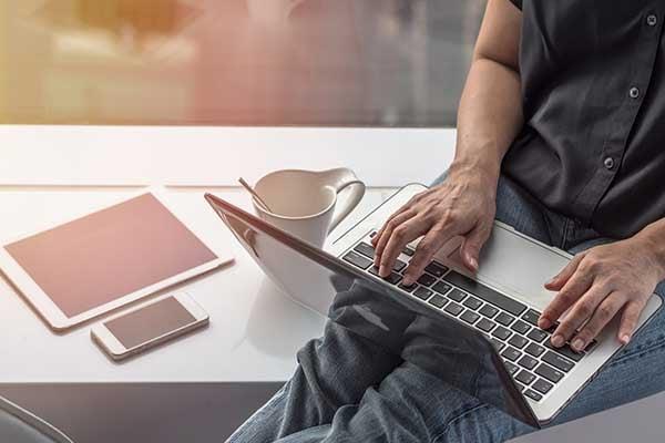Man banking online using a laptop