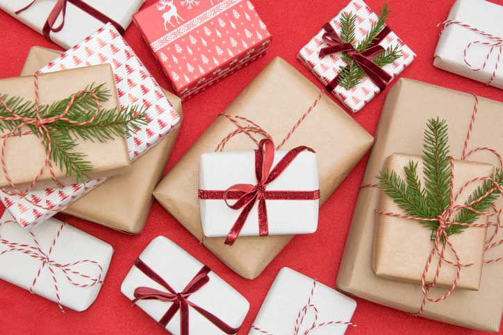 Wrapped Christmas gifts on red background
