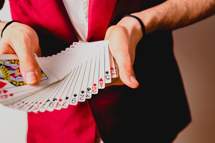 Investing isn't magic, deck of cards fanned out